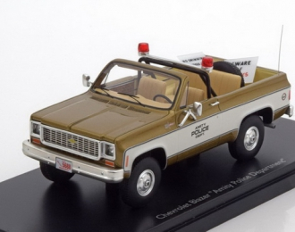 "CHEVROLET Blazer ""Amity Police Department"" (1972), golden / white"